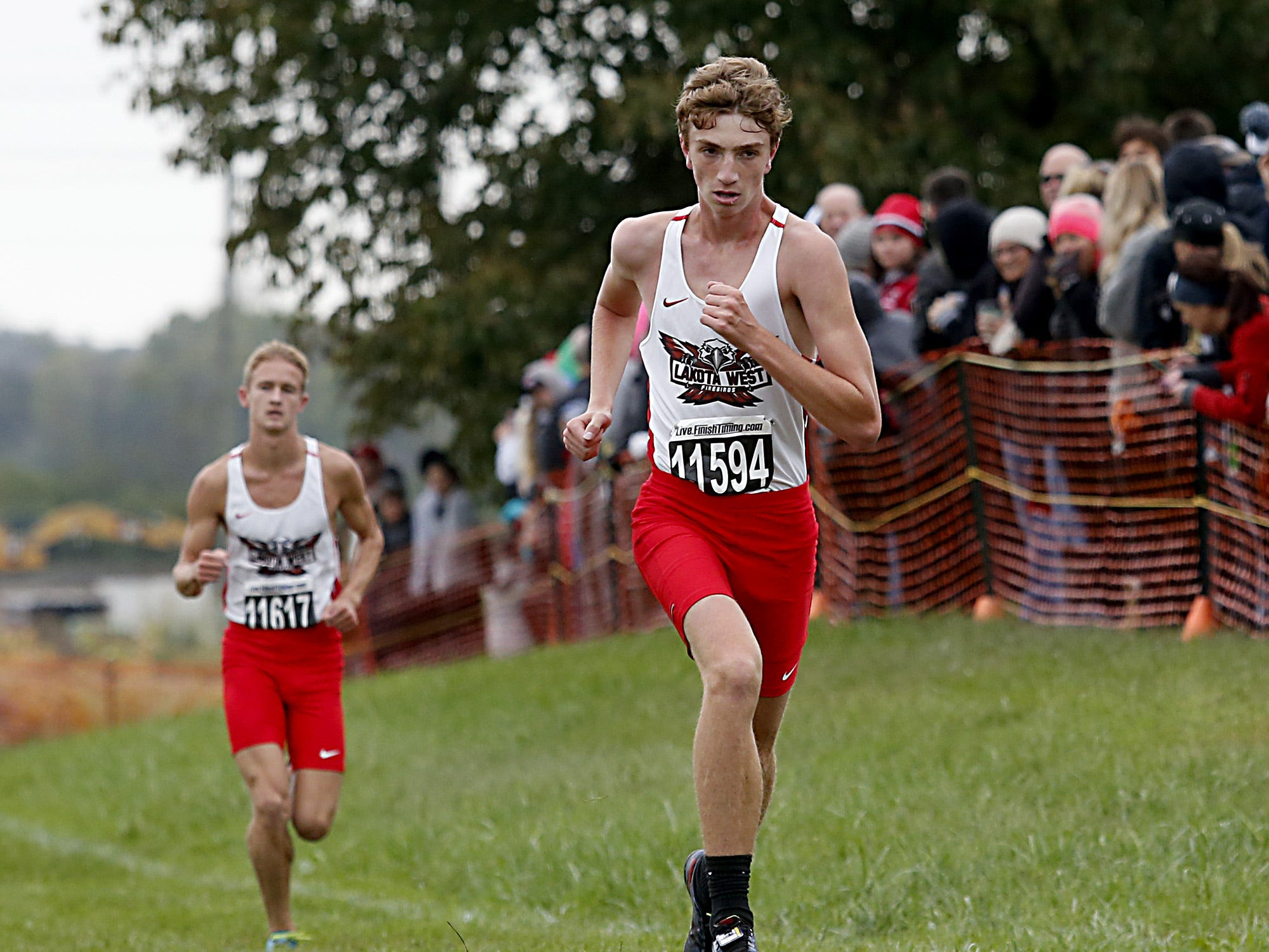 Zach Beneteau, from Lakota West, finishes 10th during the Greater Miami Conference Girls and Boys Cross Country Championships at Voice of America Park in West Chester Saturday, Oct. 13, 2018.