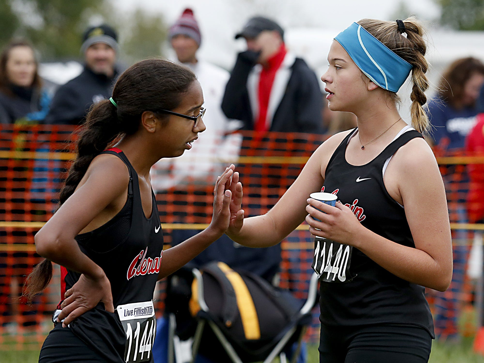 Colerain teammates Macia Turley and Eleanor Taphorn congratulate each other during the Greater Miami Conference Girls and Boys Cross Country Championships at Voice of America Park in West Chester Saturday, Oct. 13, 2018.