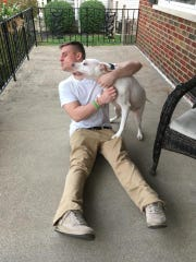 Dan Stieritz gets a happy welcome home from his dog, Nilla.