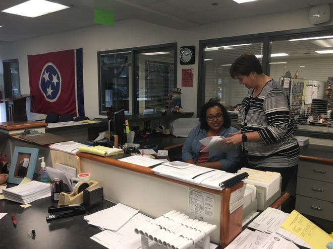 Montgomery County Administrator of Elections Elizabeth Black, standing, and Charrelle Burney of the Election Commission staff prepare for what is expected to be the year's biggest voter turnout leading up to Nov. 6.