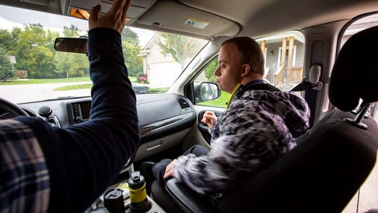 Ben Jones, a 27-year-old man from Johnston with Down syndrome, is driven to his job at a Grimes retirement community by driver Megan Winjum Thursday, Oct. 11, 2018.