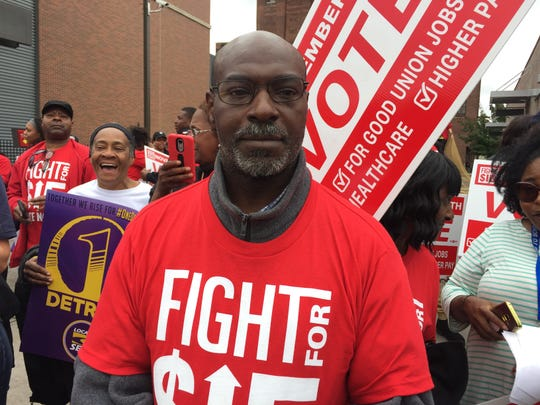 Claybon Guinn of Detroit was among hundreds of workers protesting outside a McDonalds in Midtown Detroit on October 2, 2018 for a $15-an-hour minimum wage.