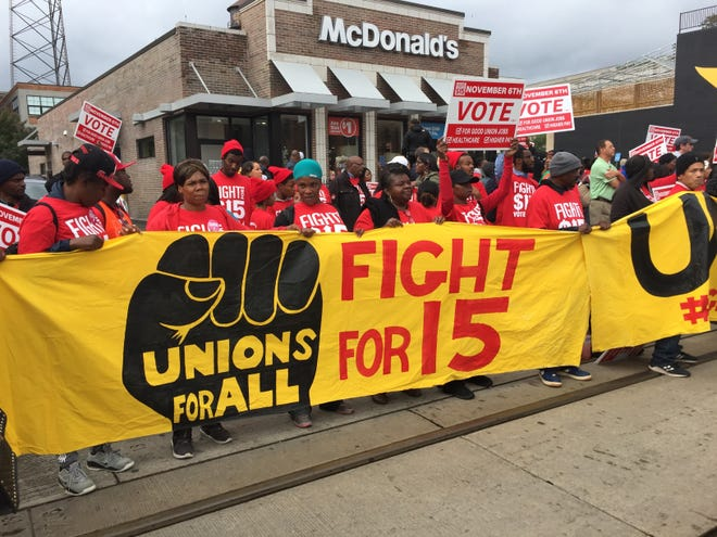 Fast-food workers and supporters protest to demand a $15-an-hour minimum wage outside a McDonald's in Midtown Detroit on Oct. 2, 2018.