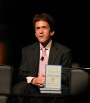 Mitch Albom talks with the audience during his charity book launch for The Next Person You Meet In Heaven, held to raise money for the children of Haiti and Detroit, Sunday, Oct. 14, 2018 at the Detroit Opera House.