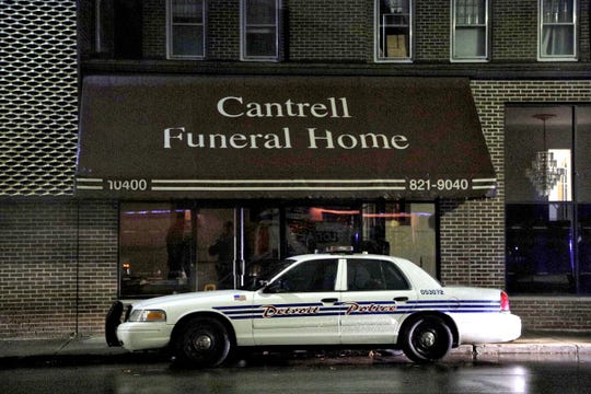 A Detroit Police vehicle parked outside of the Cantrell Funeral Home in Detroit on Friday, October 12, 2018. The decomposed bodies of 11 infants were found in the ceiling of the former funeral home on Oct. 12, 2018.