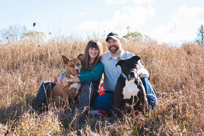 Rachel and Robby Peterson of Ionia, Mich., with their dogs, Ditka and Hector.