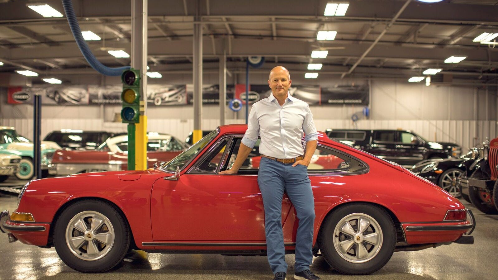 McKeel Hagerty stands with his 1967 Porsche 911S which he bought for $500 when he was 13 and restored it in the garage with his Dad. It was his first car and he still owns it 37 years later.