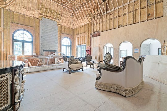 Four-story, 16,855-square-foot home on Grosse Ile has eight bedrooms and a 300-foot Tanglewood Conservatory prepped for a pool.