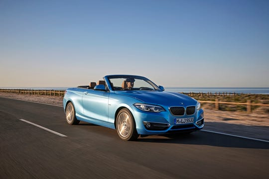 2018 BMW M240i convertible provides soft-top entertainment in sporty, compact two-door sedan.