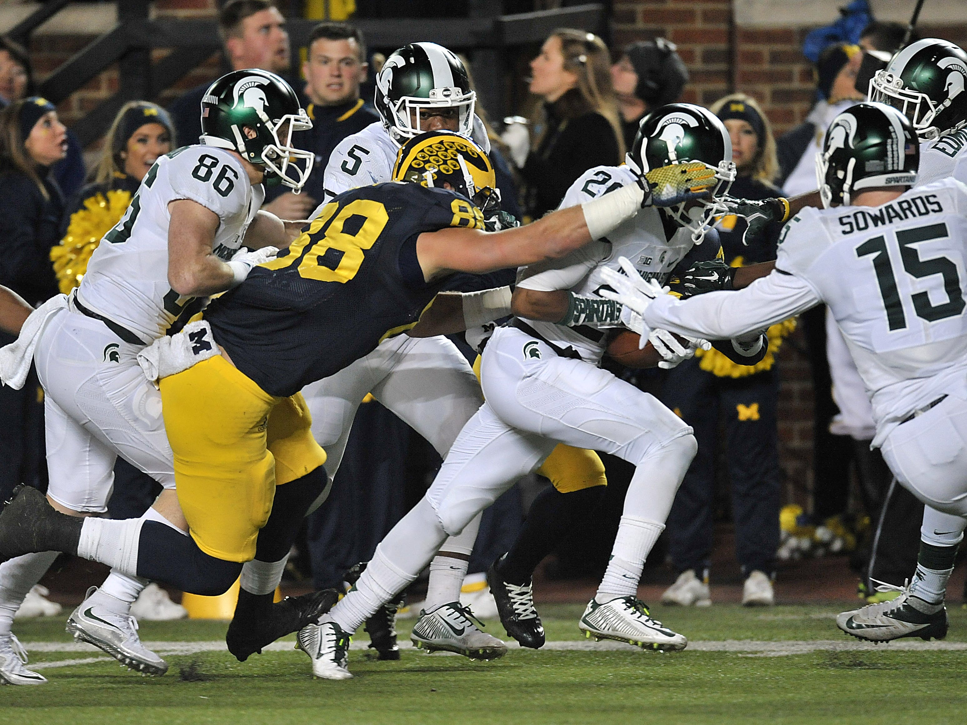 """MICHIGAN-MICHIGAN STATE: They first played in 1898, and they play, fittingly, for the Paul Bunyan Trophy, which has been dominated by the Spartans in recent years -- often with memorable wins, like the epic """"Trouble with the Snap"""" moment at the Big House in 2015."""