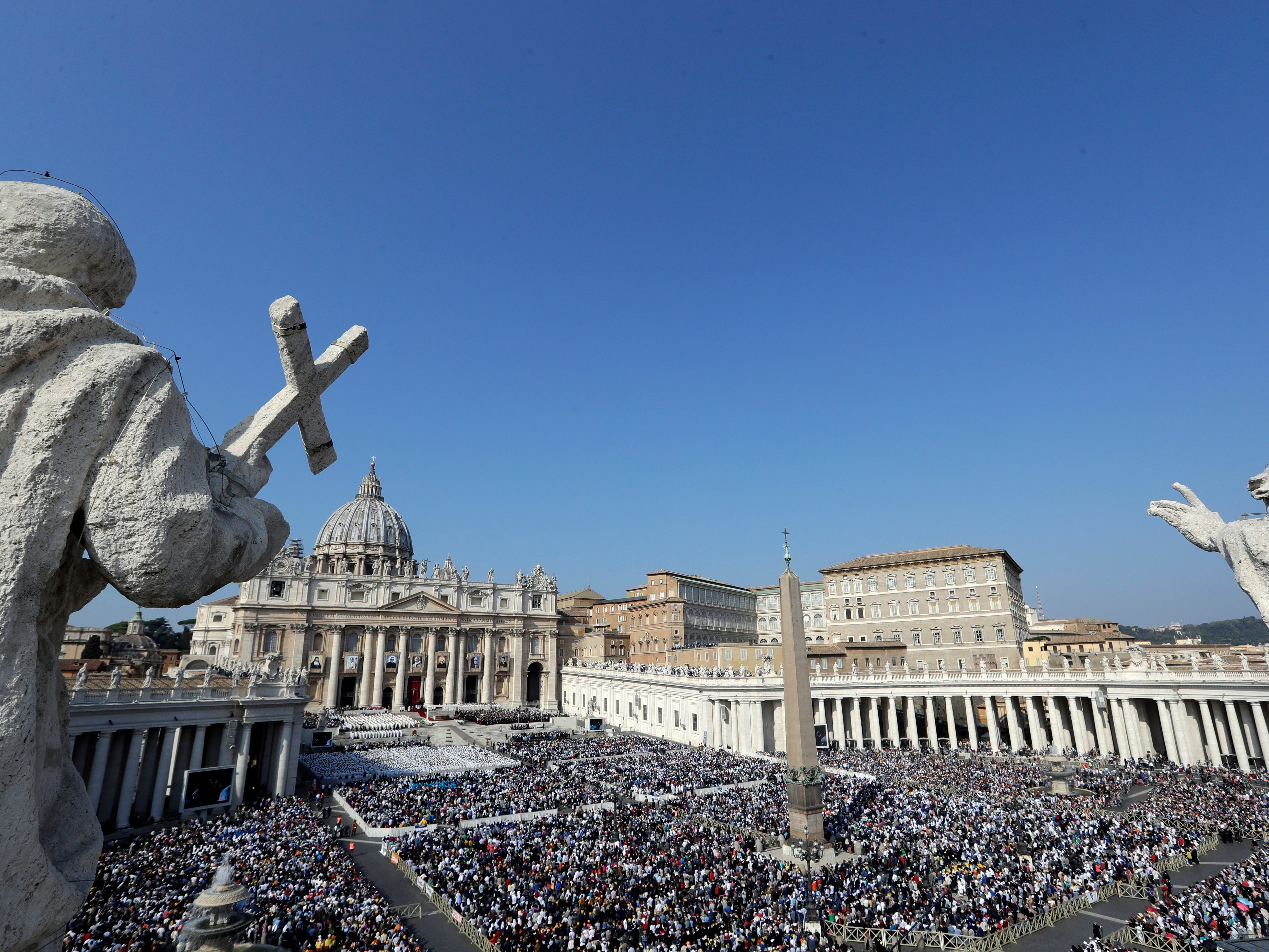 A view of St. Peter's Square during a canonization ceremony presided over by Pope Francis, at the Vatican, Sunday, Oct. 14, 2018. Pope Francis has lauded new saints Pope Paul VI and slain Salvadoran Archbishop Oscar Romero as prophets of a church that looks out for the poor as he presided over a canonization ceremony.