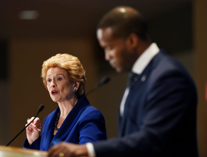 U.S. Sen Debbie Stabenow,  speaks while her Republican challenger John James waits for his turn during their debate Monday before the Detroit Economic Club in 2018.