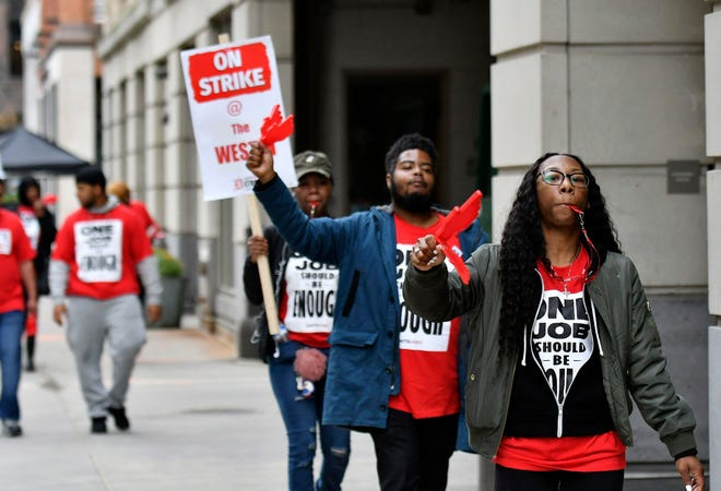 The Westin Book Cadillac hotel could lose an elite conference of global leaders gathering here in two weeks if it doesn't resolve an ongoing strike of its service workers, conference organizers said Monday.