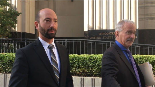 Detroit City Councilman Gabe Leland, left, leaves Detroit federal court with attorney Steve Fishman after being released on bond in a public corruption case in 2018.
