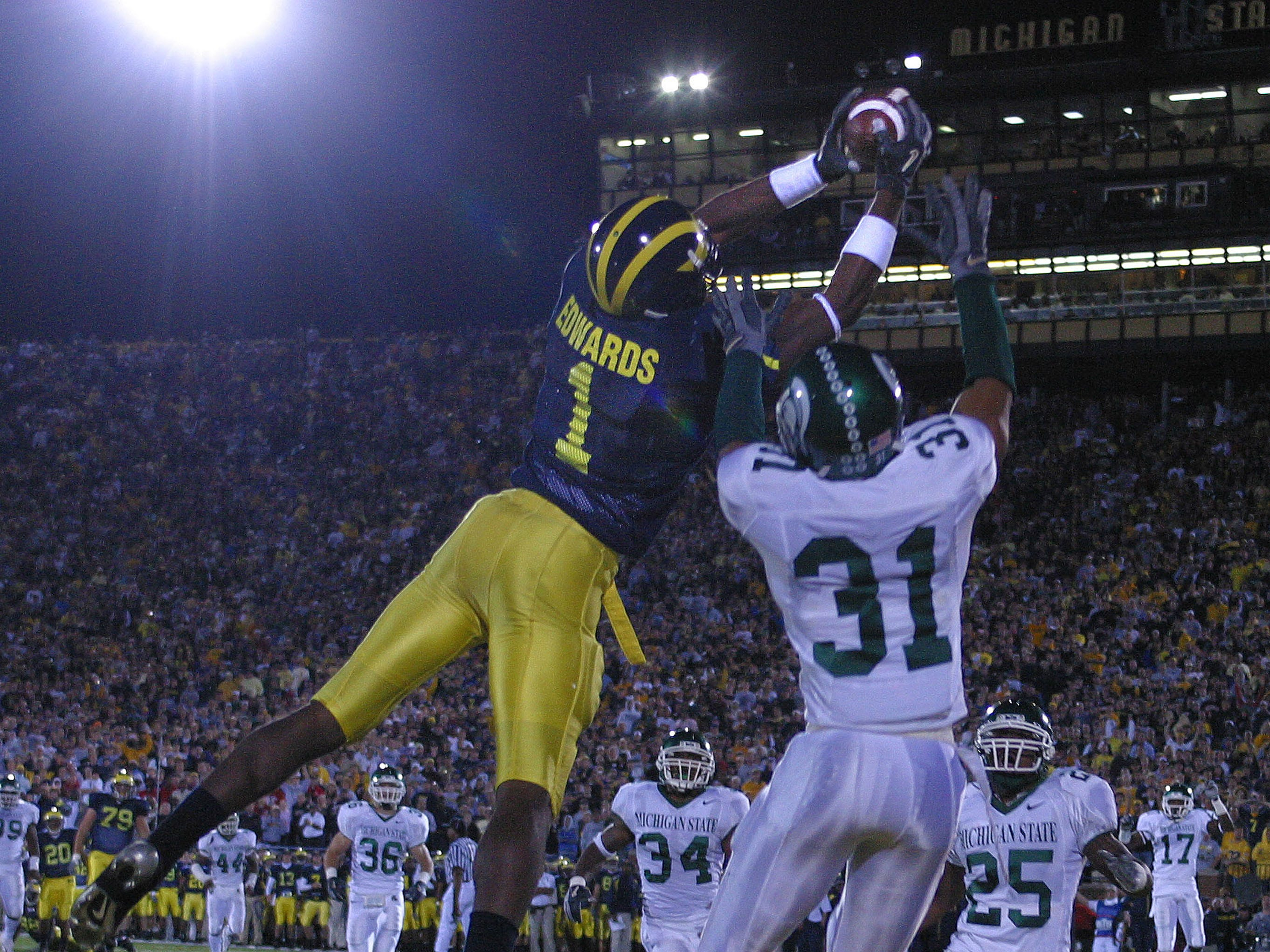 MICHIGAN STATE-MICHIGAN: To be fair (and to limit the phone calls!), we must include a picture of a memorable Michigan moment, too, like Braylon Edwards' epic game in the Wolverines' triple-OT victory in Ann Arbor in 2004.