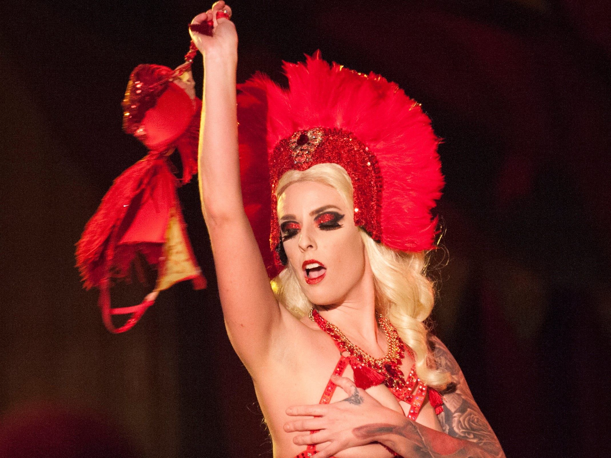 Burlesque performer Magenta DeMure teases the audience at the Dirty Devils Peepshow on the fifth floor.