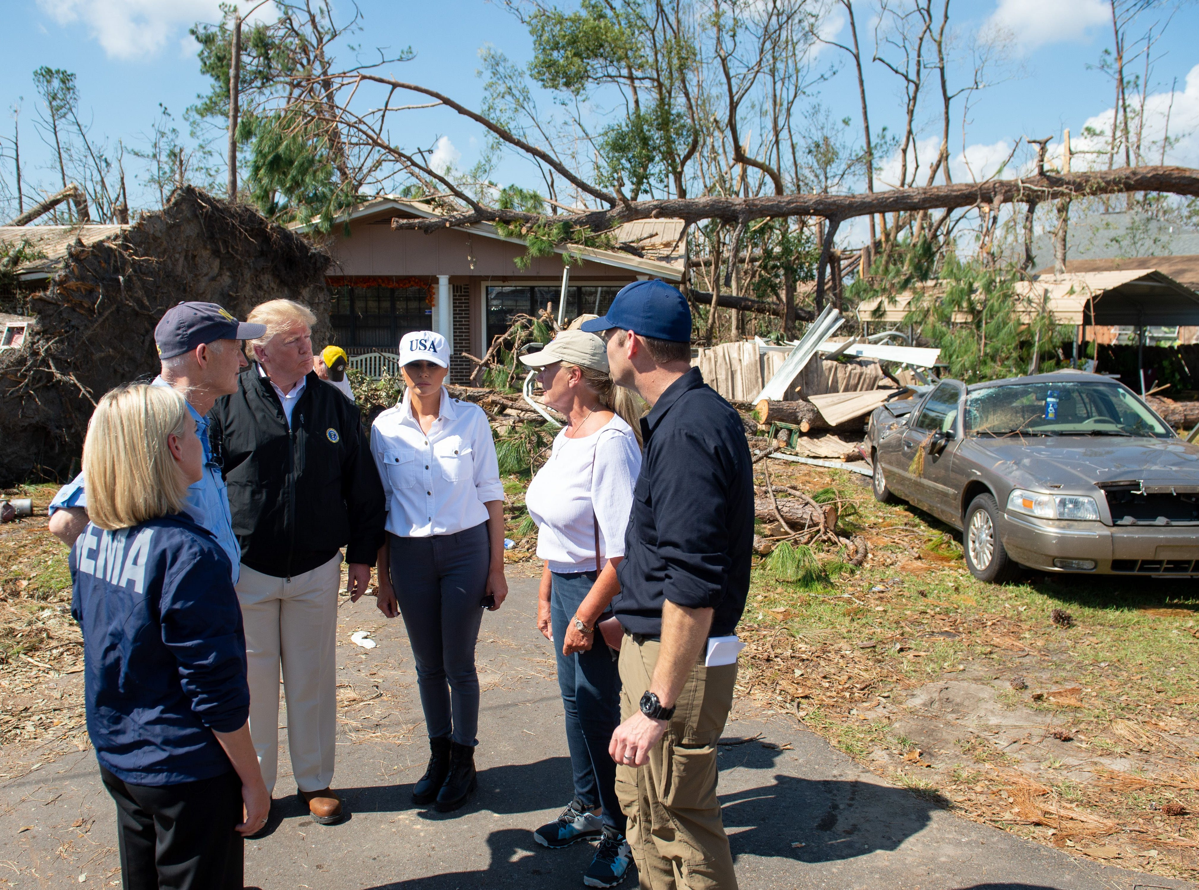 President Donald Trump and first lady Melania Trump tour damage from Hurricane Michael in Lynn Haven, Florida, October 15, 2018.