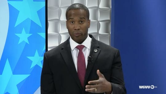 Republican challenger John James answers a question during a debate with U.S. Senator Debbie Stabenow at Grand Valley State University on Sunday, October 14, 2018 (still frame from video)