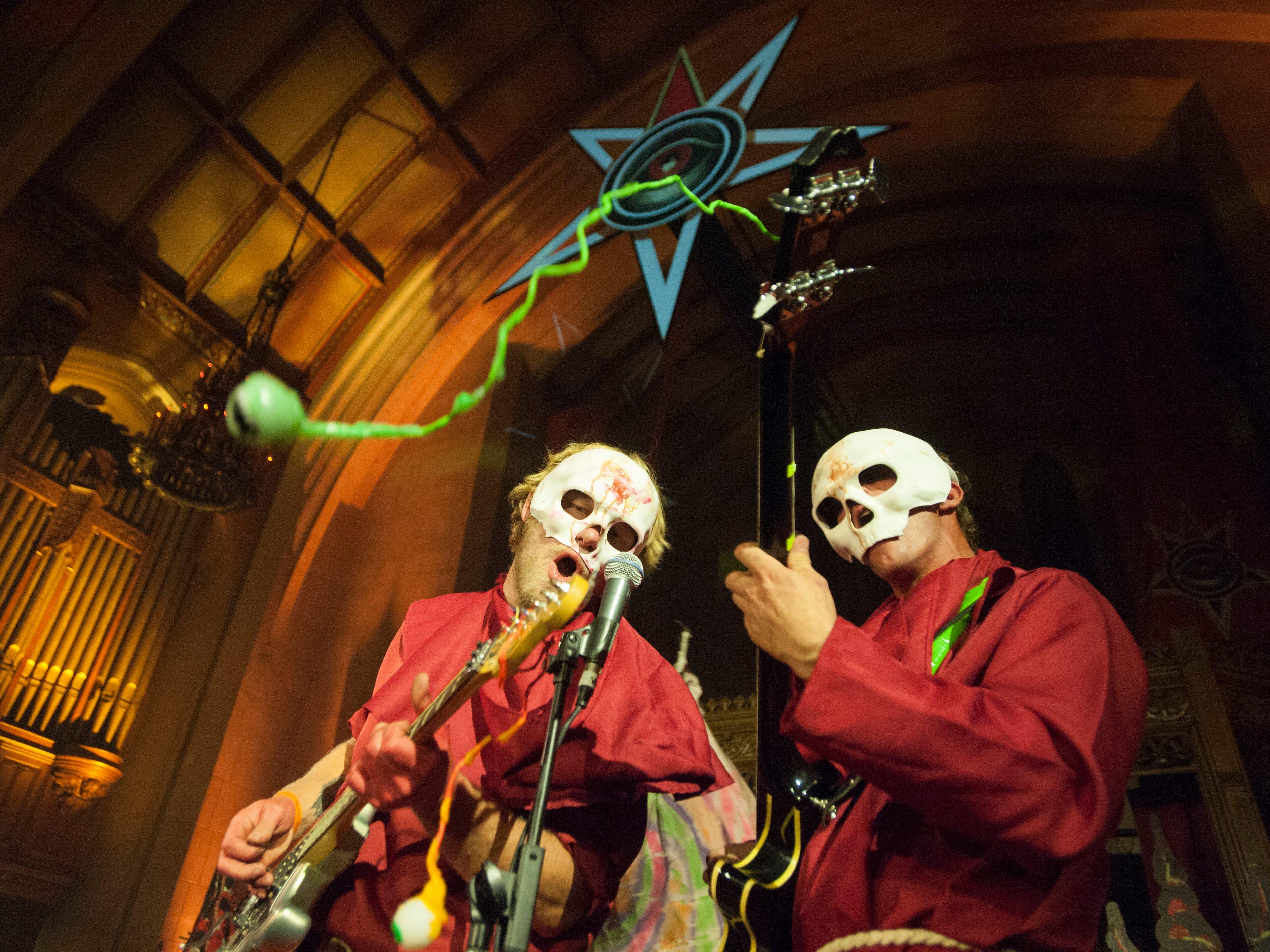 Theatrical rockers Krillin vs. Spaceskull perform on 'The Asylum' stage.