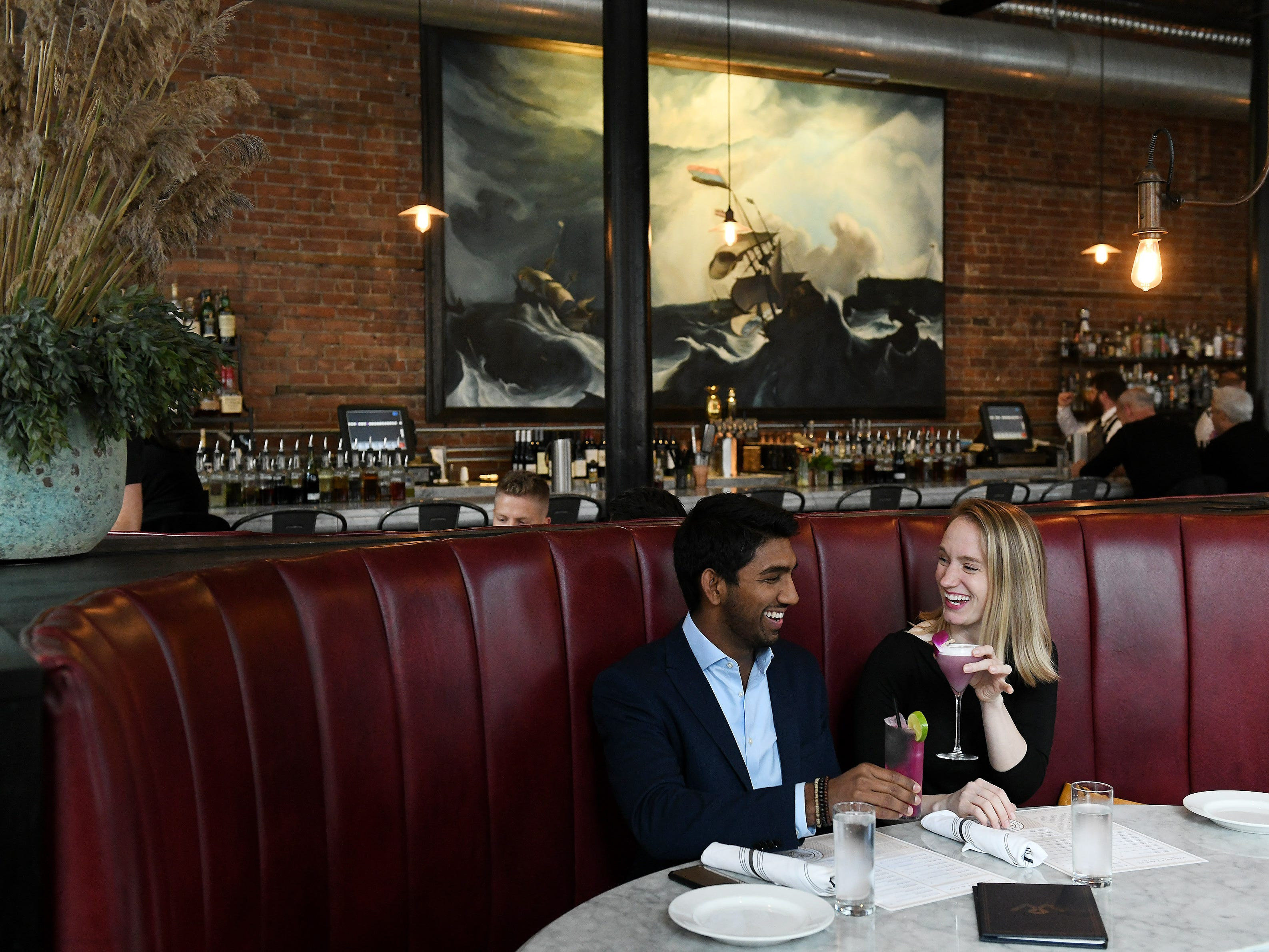 Sweethearts Julia Dart and Shiv Ganganithi cheers each other celebrating six years of being together with a special evening at Wright & Compnay in Detroit on Oct 11, 2018.