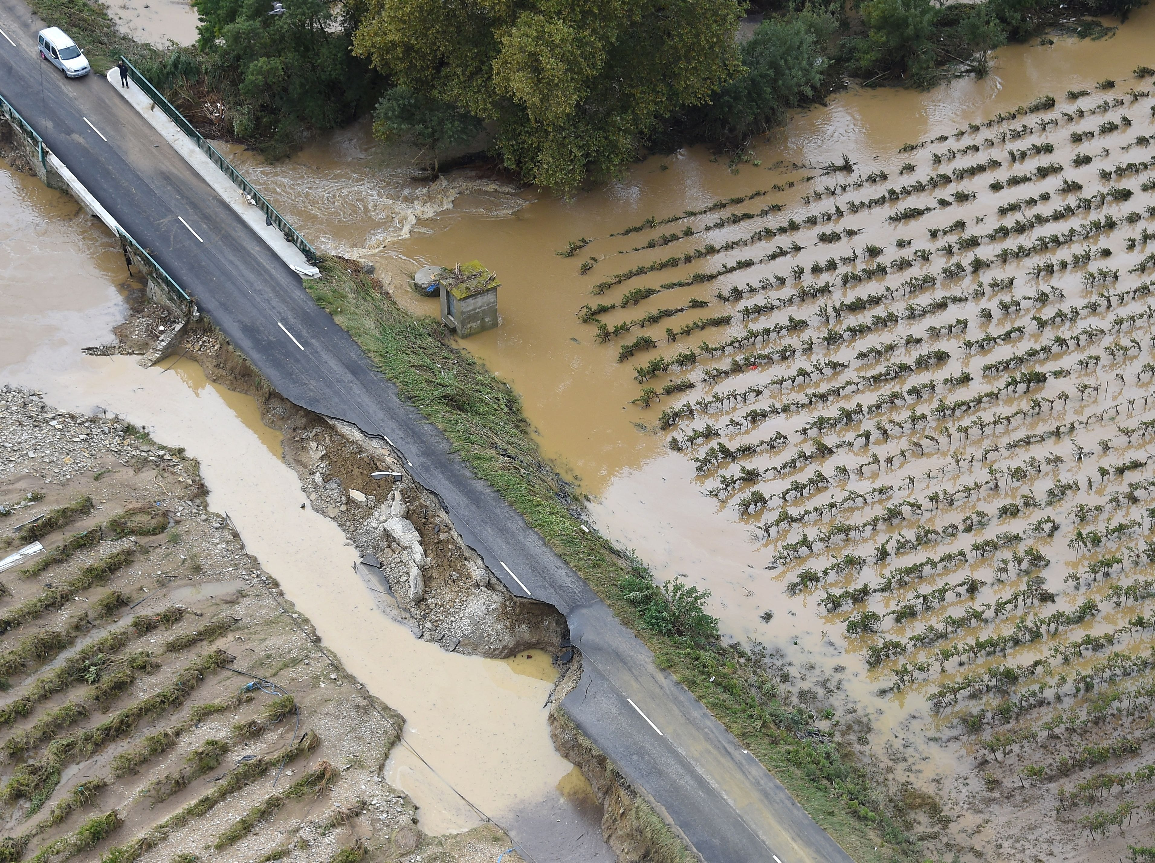 A road washed out October 15, 2018, near Carcassone in southern France. Thirteen people have died after severe storms caused flash flooding across wide stretches of southwest France overnight, the interior ministry's rescue service said.