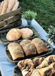 Breads from Because Bread bakery, from rear: Baguettes, artisan white loaf, sandwich loaf with herbs, apple butter cinnamon twist.