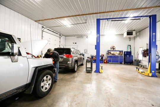 Robert Tenorio, of Tenorio Auto Repair, works on a vehicle in his shop Thursday, Oct. 11, 2018.
