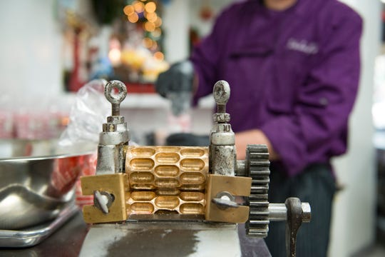 A crank mold of hard candy sits on the production line at the Colorado Candy Company on Monday, October 15, 2018. The Fort Collins company specializes in hard candies and brittles in small batches.