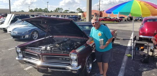 Lee County classic car collector Al Colacicco with his 1967 Pontiac GTO, one of the classic exhibited at Merchants Crossing in North Fort Myers. A technicality in the zoning code had reduced the weekly car shows, requiring a 45 days with no shows after a month of regular Monday exhibitions.  A Lee County Hearing examiner said last week she will recommend that the county make a change.