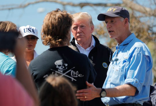 President Donald Trump, accompanied by First Lady Melania Trump, Florida Gov. Rick Scott, and FEMA director Brock Long, visited the city of Lynn Haven, Florida in the aftermath of Hurricane Michael Monday, October 15, 2018. A large parking area behind the devastated police department and City Hall buildings became a temporary location for local volunteers and people to compile and distribute supplies, food and assistance.