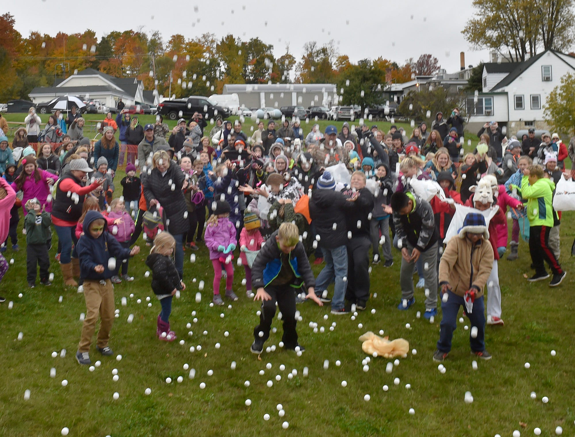 It is raining pingpong balls in the children's area during the 73rd annual Sister Bay Fall Fest's popular pingpong drop on Oct 14, 2018. Tina M. Gohr/USA TODAY NETWORK-Wisconsin
