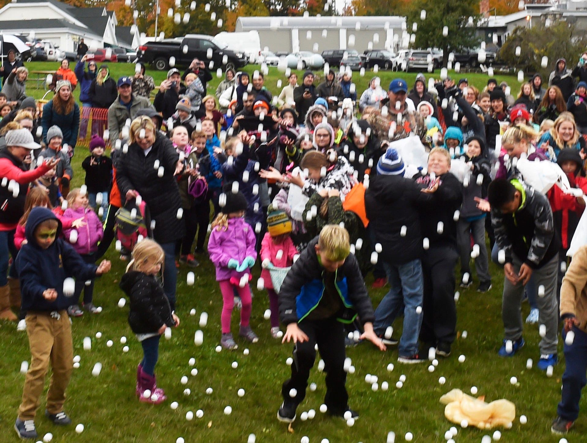 Not only did it sprinkle nearly all day Sunday in Sister Bay, it was raining pingpong balls at the 73rd annual Sister Bay Fall Fest on Sunday, Oct. 14, 2018.  Pingpong ball were shot from an air cannon in a downtown green space provided for the children's area. It was followed by an adult drop on closed-off State 42 from four air cannons in downtown Sister Bay. Nearly 6,000 pingpong balls were shot off with some carrying free prizes from area businesses written on the outside of the ball. Tina M. Gohr/USA TODAY NETWORK-Wisconsin