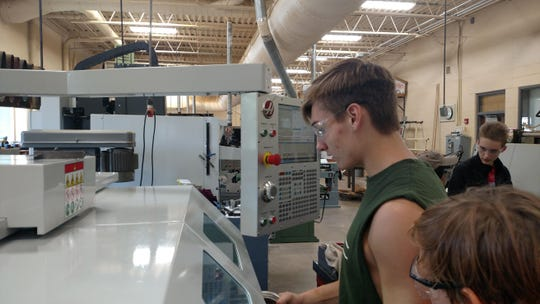 Webster High School Student, Wyatt Schaaf, machines his first part on the new Haas TL-1 CNC Lathe.