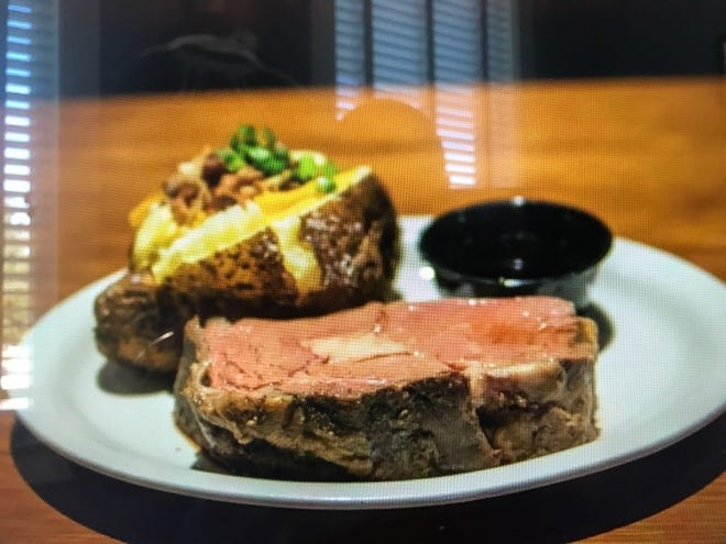 J. Peters Grill & Bar features steaks, seafood, sandwiches and salads.