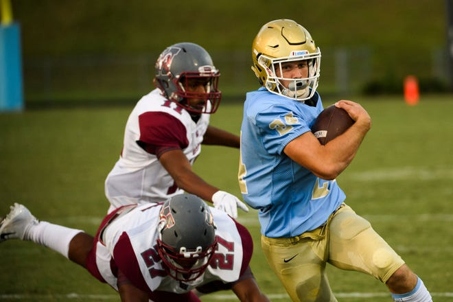 Daniel quarterback Tyler Venables, right, passed for 240 yards, rushed for 95 and accounted for three touchdowns in the Lions' 51-31 win over Wren.