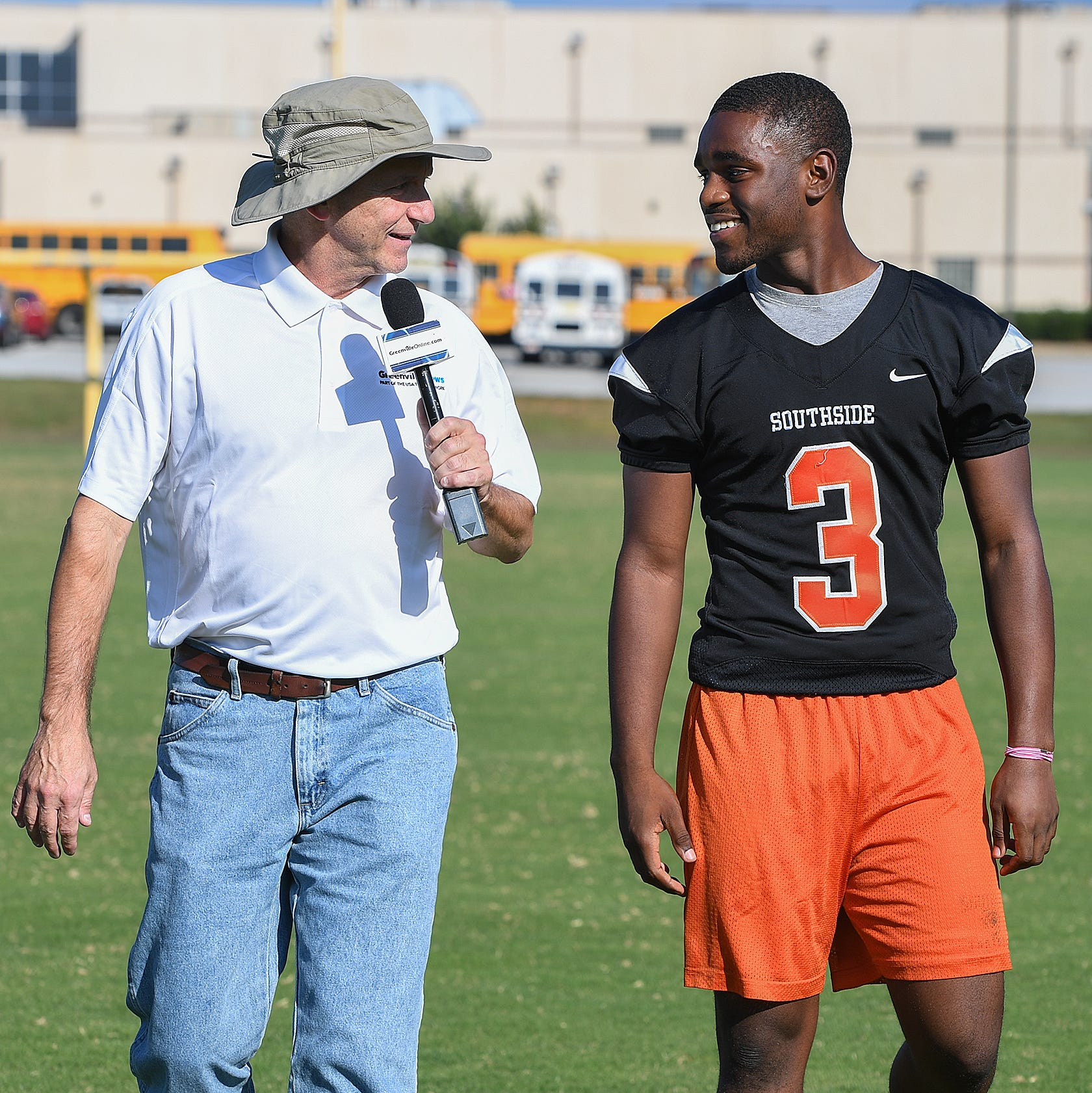 The Greenville News' Bob Castello walks 100 yards with Southside's Zion Kelly Monday, October 15, 2018.