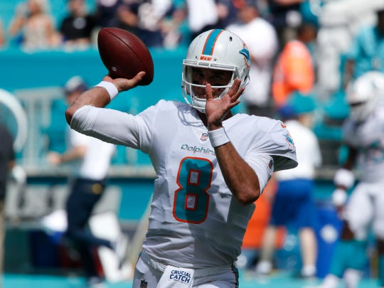 Dolphins quarterback Brock Osweiler  warms up before Sunday's game against the Bears in Miami.