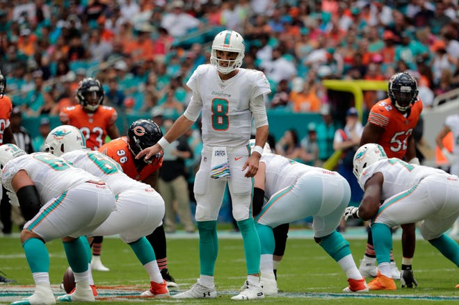 Dolphins quarterback Brock Osweiler calls a play during the first half against the Chicago Bears Sunday in Miami.