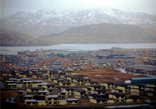 In this February 1997 file photo, hundreds of houses, which over 6,000 military personnel and dependents called home, along with schools, warehouses, hangars, and other structures sit empty on the Adak Naval Air Facility in Alaska. The Trump administration is considering using West Coast military bases or other federal properties as transit points for shipments of U.S. coal and natural gas to Asia.
