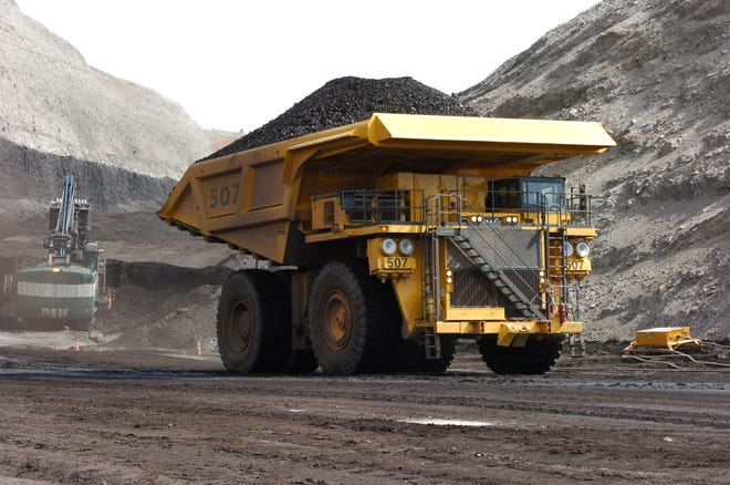 FILE - In this April 4, 2013, file photo, a mining dumper truck hauls coal at Cloud Peak Energy's Spring Creek strip mine near Decker, Mont. The Trump administration is considering using West Coast military bases or other federal properties as transit points for shipments of U.S. coal and natural gas to Asia.