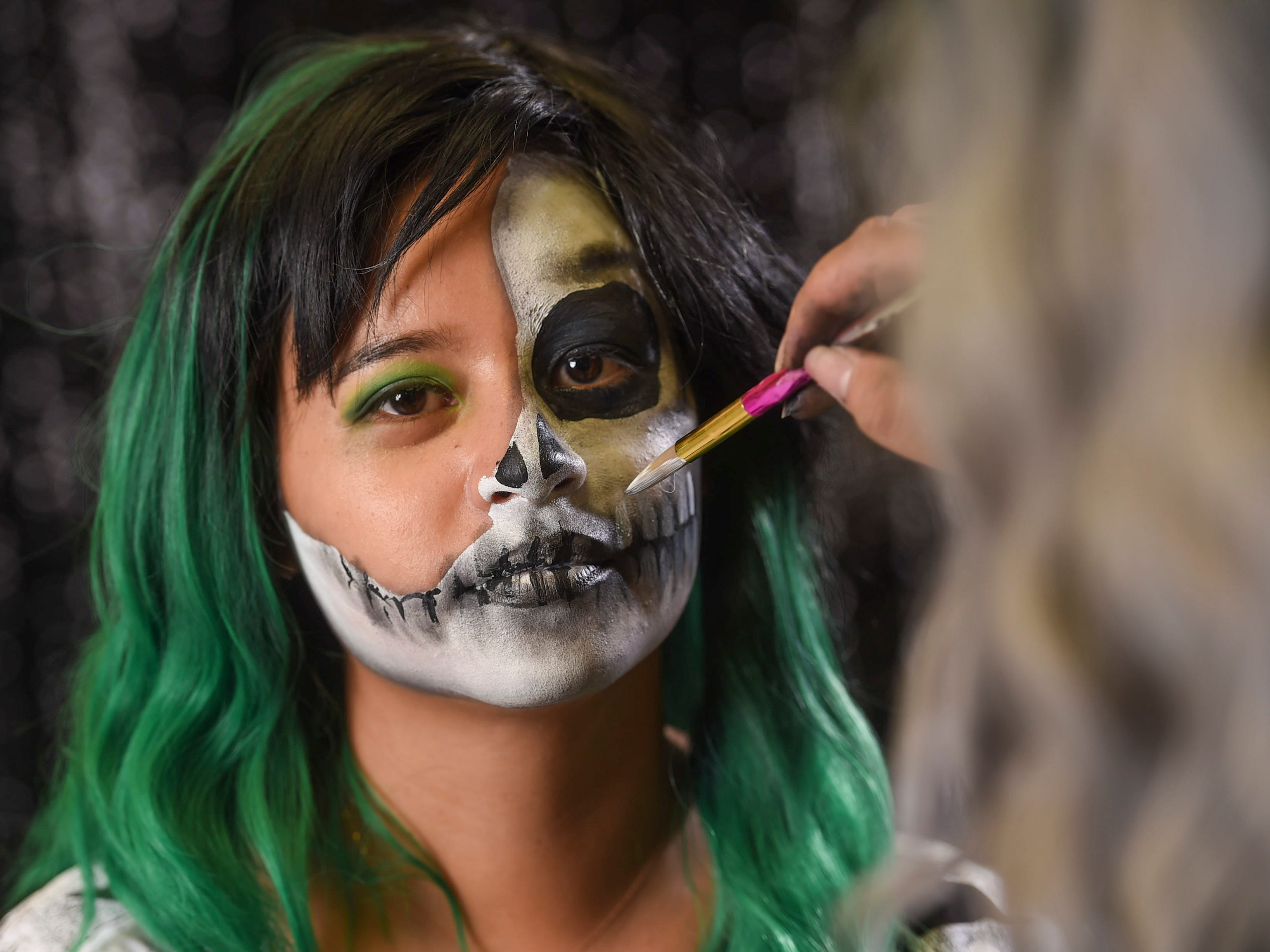Use gray and black eye shadow to shade around the skull face for detail.