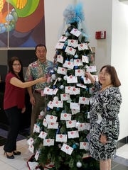 Bank of Hawaii continues its partnership with Sugar Plum Tree for their 2018 launch in Hagåtña, Oct. 15, 2018. From left: Bank of Hawaii Senior Vice President Erlinda Alegre, Mark Tokito, Bank of Hawaii senior vice president and manager, and Bobbie Leon Guerrero, Sugar Plum Tree president and executive director.