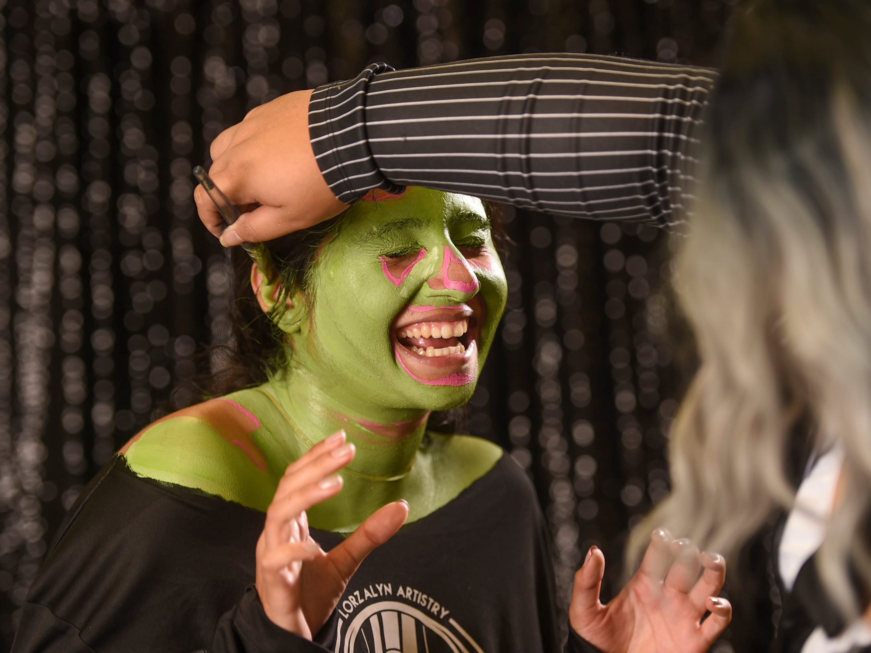 Get green water-based face paint all around the ears.