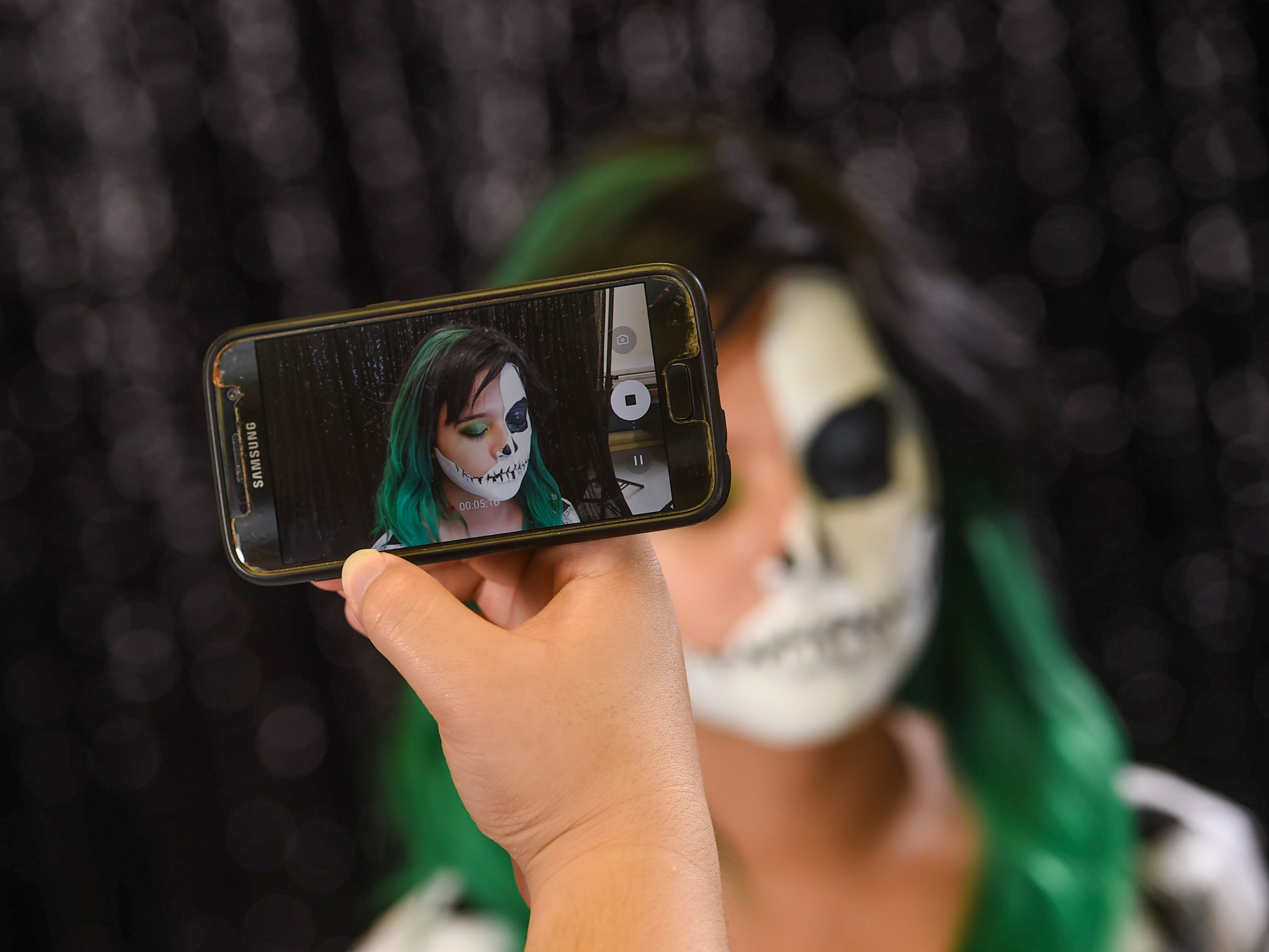 The makeup process can be photographed with any cellular phone.