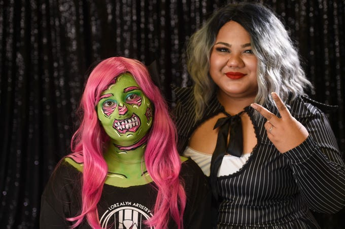 Pacific Daily News reporter Anumita Kaur as a pop art zombie with Maria-Loralyn Romulo, Lorzalyn Artistry owner and makeup artist, Oct. 9, 2018.