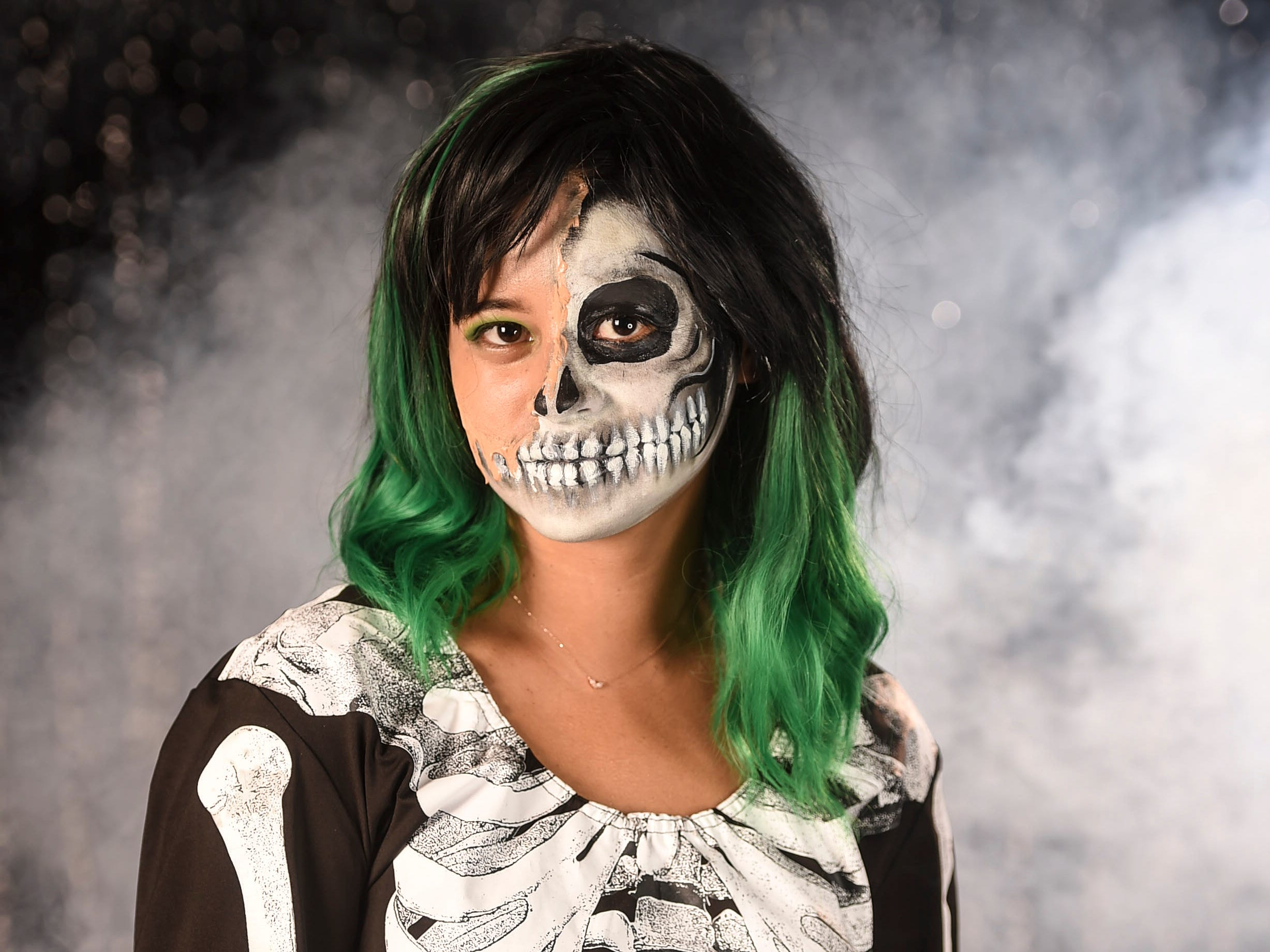 Pacific Daily News reporter Chloe Babauta sports a skeleton costume, green wig, and half skull makeup, Oct. 9, 2018.