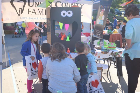 Children check out the Union County Family Dental booth.