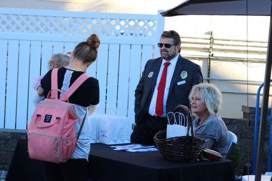 Judge Executive Adam O'Nan and Nyra Syers of Job Corps talk to guests at the festival event.
