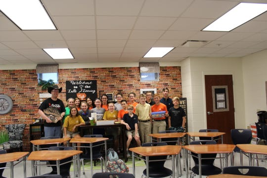Mr. Drennan with JPII middle school students, sharing his story of the project that took place.