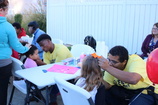 Job Corps students painted faces during the event.